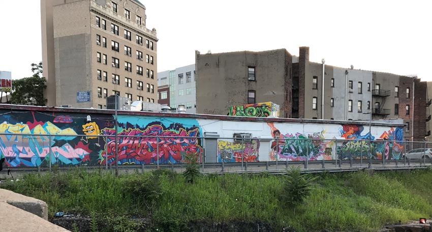 mural by arts group Green Villain seen in Jersey City