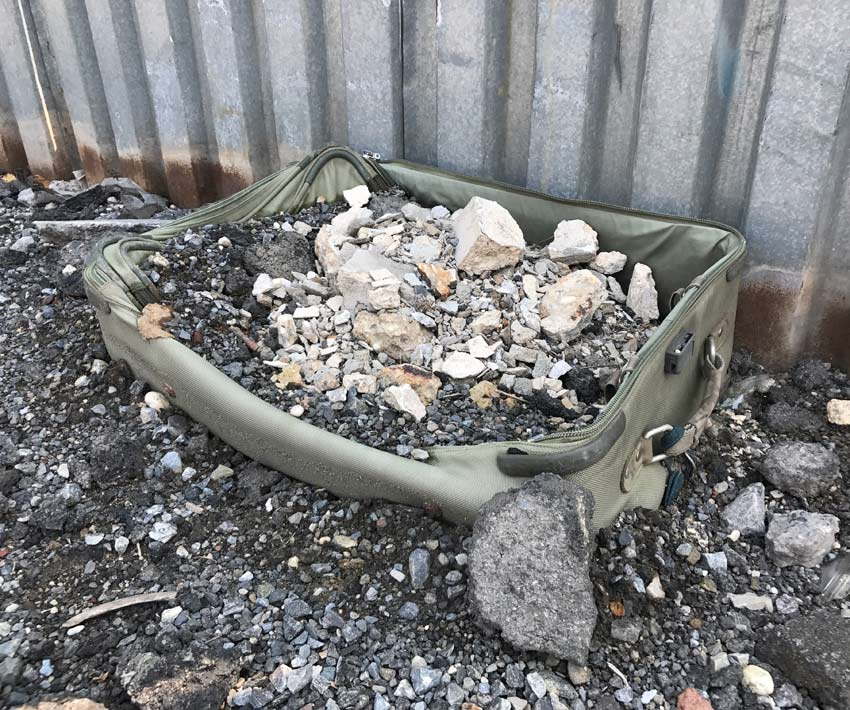 suitcase filled with rubble on Morgan Avenue in Brooklyn