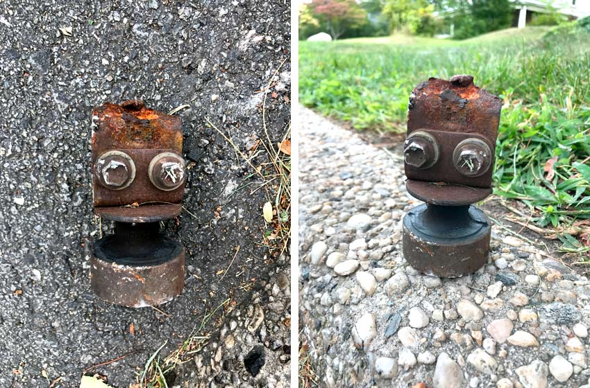 found piece of rusty metal that looks like a robot head with 2 eyes