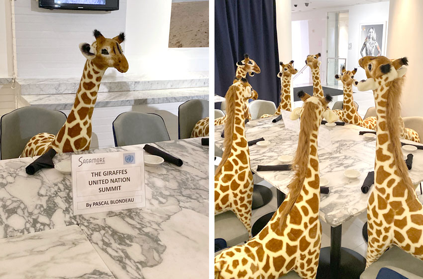 stuffed animal giraffes art installation by Pascal Blondeau
