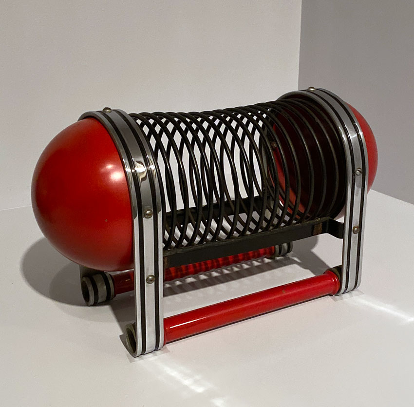 Magazine rack designed by James Waring Carpenter for the McKaycraft line