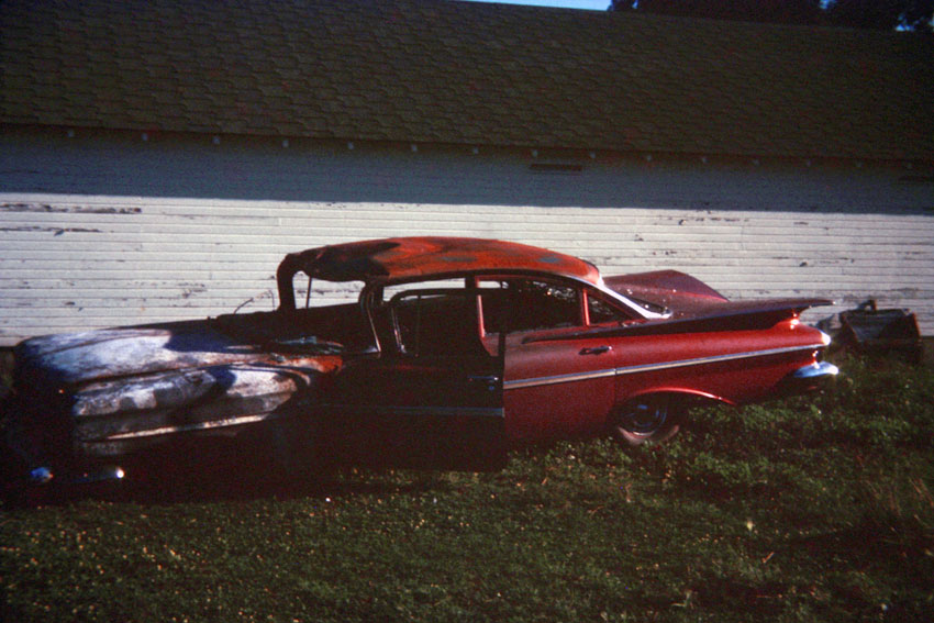 burned out car 1959 Chevrolet Impala on an Iowa farm