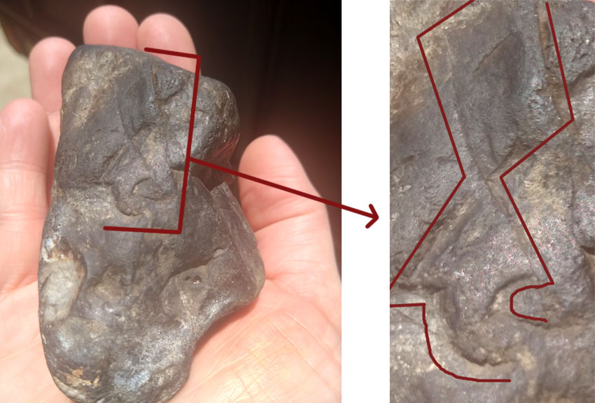 carved arrow on the surface of a rock found in Texas