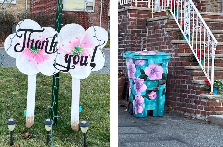 hand painted sign with pink flowers and also a garbage can with pink flowers