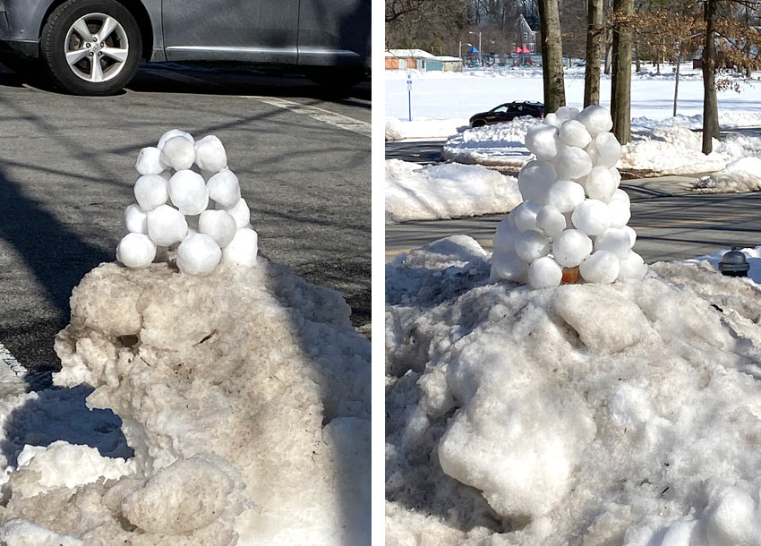 snowball art - two piles of snowballs on a street corner in Montclair